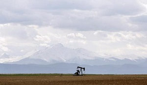 An oil derrick can be seen in a field near Denver, Colorado